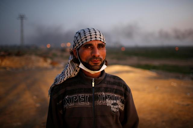 """<p>A Palestinian protester poses for a photograph at the scene of clashes with Israeli troops near the border with Israel, east of Gaza City, Jan. 12, 2018. """"We want to say to Trump that Jerusalem is an essential part of our bodies that we cannot survive without. We are in love with Jerusalem and are ready to sacrifice everything, even our souls, to protect it as the capital of Palestine. If the world is fair, it should end our hard living conditions which resulted from the Israeli occupation,"""" he said. (Photo: Mohammed Salem/Reuters) </p>"""