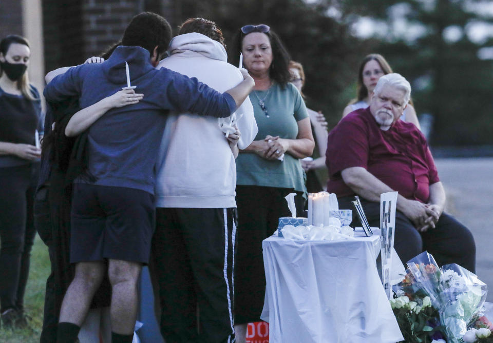 Friends and family of gather for a vigil for the Jackson family.