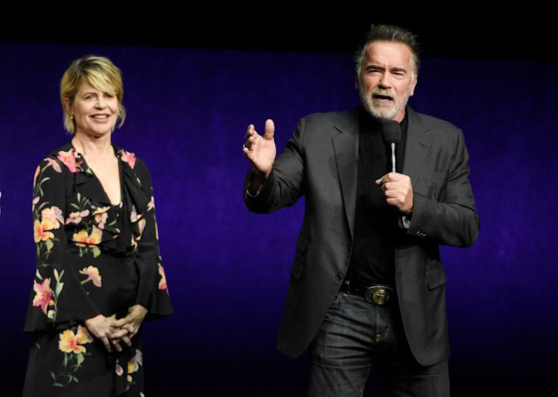 "Arnold Schwarzenegger, right, a cast member in the upcoming film ""Terminator: Dark Fate,"" talks about the film as fellow cast member Linda Hamilton looks on during the Paramount Pictures presentation at CinemaCon 2019, the official convention of the National Association of Theatre Owners (NATO) at Caesars Palace, Thursday, April 4, 2019, in Las Vegas. (Photo by Chris Pizzello/Invision/AP)"