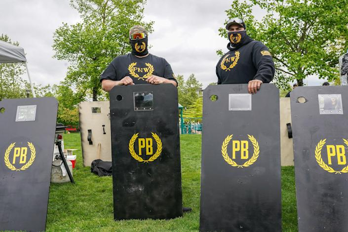 <p> Proud Boys provide security at a 2nd Amendment rally on 1 May 2021 in Salem, Oregon</p> (Getty Images)