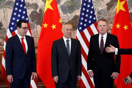 FILE PHOTO: Chinese Vice Premier Liu He, U.S. Treasury Secretary Steven Mnuchin and U.S. Trade Representative Robert Lighthizer arrive for a group photo session after concluding their meeting at the Diaoyutai State Guesthouse in Beijing