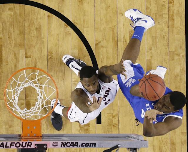 Kentucky center Dakari Johnson, right, shoots over Connecticut forward Phillip Nolan during the first half of the NCAA Final Four tournament college basketball championship game Monday, April 7, 2014, in Arlington, Texas. (AP Photo/David J. Phillip)