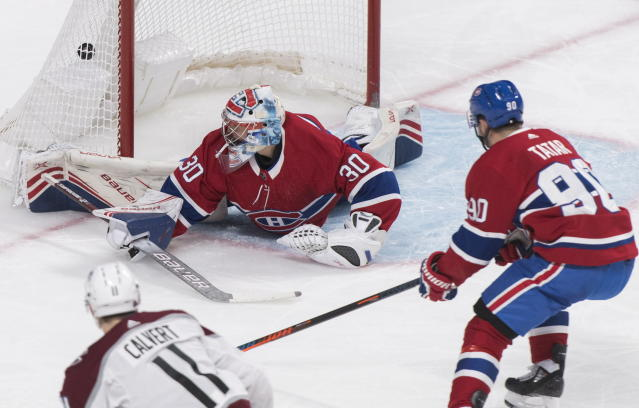 Colorado Avalanche's Matt Calvert (11) scores against Montreal Canadiens goaltender Cayden Primeau as Canadiens' Tomas Tatar defends during the second period of an NHL hockey game Thursday, Dec. 5, 2019, in Montreal. (Graham Hughes/The Canadian Press via AP)