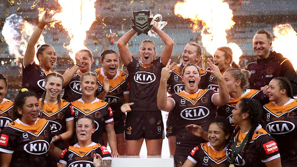 The Brisbane Broncos are pictured celebrating their NRLW premiership victory.