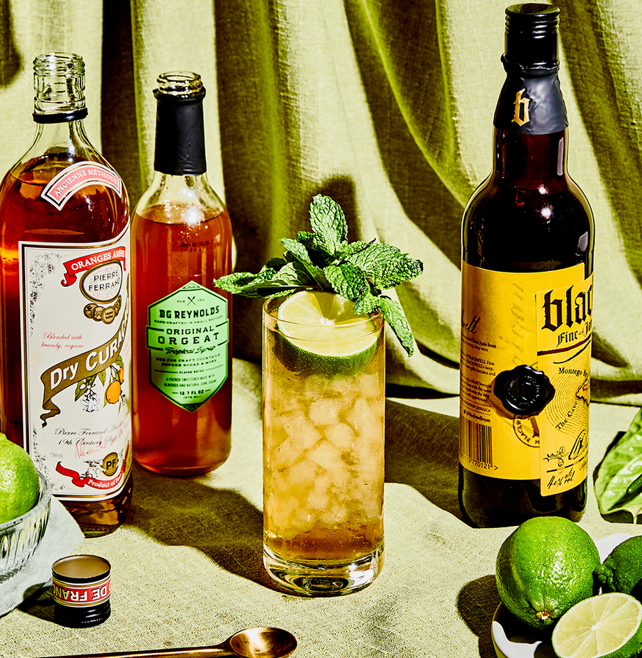"""<p><em>There are many wrong ways to make a Mai Tai. This is the right way.</em> </p><p><strong>Ingredients</strong></p><p>• 2 oz. dark rum <br>• 1 oz. lime juice<br>• 1/2 oz. orange curaçao<br>• 1/2 oz. orgeat syrup<br>• 1/8 oz. rock candy syrup </p><p><strong>Directions</strong></p><p>Shake ingredients with cracked ice in a chilled cocktail shaker. Pour unstrained into a large Collins glass (or tiki mug). Garnish with half a lime shell and a sprig of mint.</p><p><a class=""""link rapid-noclick-resp"""" href=""""https://www.esquire.com/food-drink/drinks/recipes/a3732/mai-tai-drink-recipe/"""" rel=""""nofollow noopener"""" target=""""_blank"""" data-ylk=""""slk:Read More"""">Read More</a></p>"""