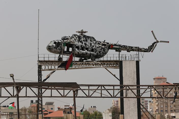 The broken helicopter of the late Palestinian Authority President Yasser Arafat sits atop a structure in Gaza City, April 29, 2019. Without its main rotor, it is now on public display in the coastal enclave that is now controlled by the Palestinian Authority's most powerful domestic rival, Hamas. (Photo: Ronen Zvulun/Reuters)