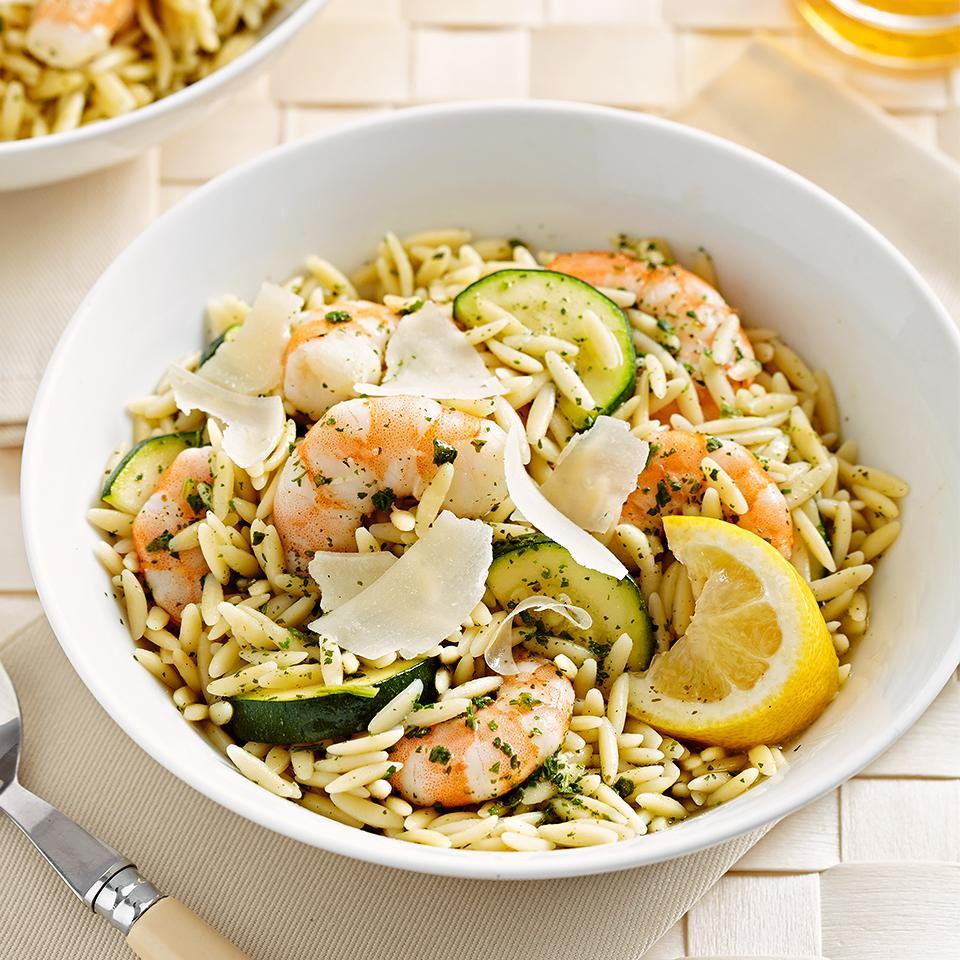 "<p>Using a packaged pesto sauce mix saves time in this 20-minute orzo pasta salad recipe. <a href=""http://www.eatingwell.com/recipe/269443/pesto-shrimp-pasta/"" rel=""nofollow noopener"" target=""_blank"" data-ylk=""slk:View recipe"" class=""link rapid-noclick-resp""> View recipe </a></p>"