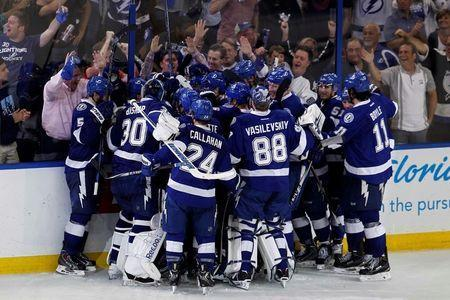 The Tampa Bay Lightning players celebrate after defeating the New York Rangers 6-5 in overtime during game three of the Eastern Conference Final of the 2015 Stanley Cup Playoffs at Amalie Arena. Mandatory Credit: Reinhold Matay-USA TODAY Sports