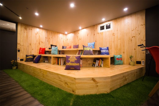 A wooden amphitheatre style library with the best books in the world for personal and professional growths.