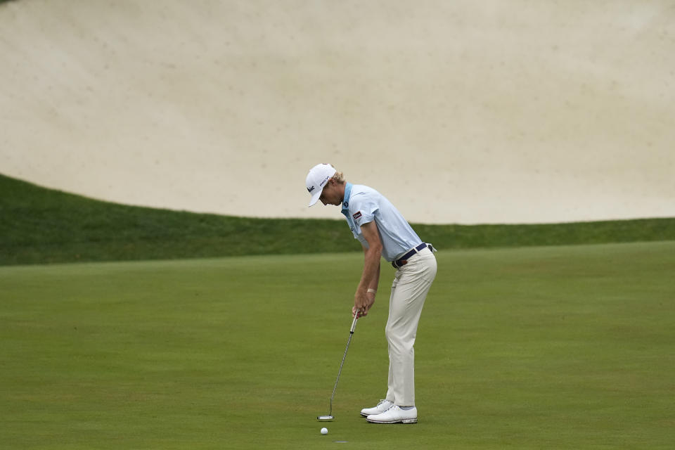 Will Zalatoris putts on the 13th hole during the third round of the Masters golf tournament on Saturday, April 10, 2021, in Augusta, Ga. (AP Photo/Gregory Bull)
