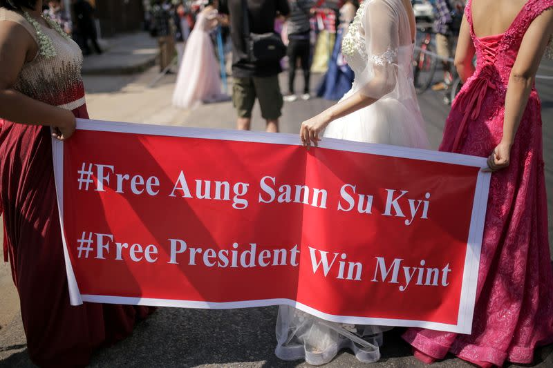 Women wearing ball gowns protest against the military coup in Yangon