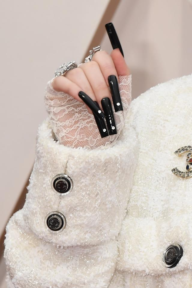 <p>Notice the small diamonds on the tips of each of her nails.</p>