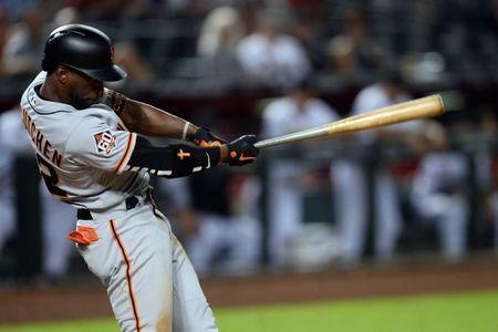 Aug 4, 2018; Phoenix, AZ, USA; San Francisco Giants center fielder Andrew McCutchen (22) hits an RBI double during the ninth inning against the Arizona Diamondbacks at Chase Field. The hit was the fifth of the game for McCutchen. Mandatory Credit: Joe Camporeale-USA TODAY Sports