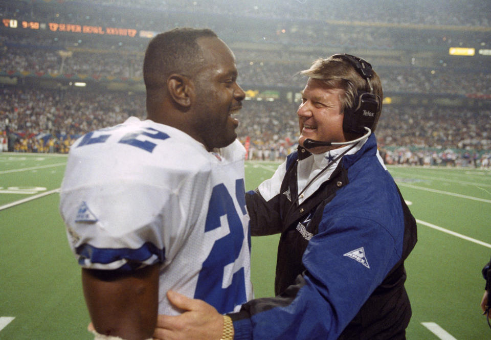 FILE - In this Sunday, Jan. 30, 1994 file photo, Dallas Cowboys' head coach Jimmy Johnson, right, talks with running back Emmitt Smith on the sidelines during the fourth quarter against the Buffalo Bills at the Super Bowl in Atlanta. Jimmy Johnson is being inducted into the Pro Football Hall of Fame. (AP Photo/Ron Heflin, File)