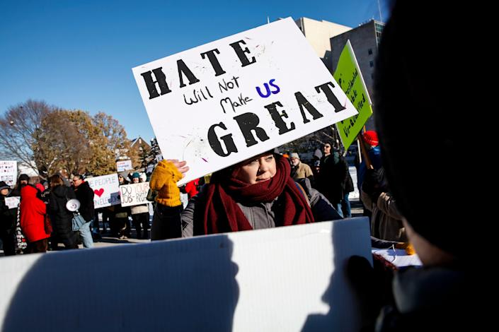 LANSING, MI - DECEMBER 19: Kate Holmes of Ann Arbor protests during a rally against President-elect Donald Trump at the Michigan State Capitol before the state electoral college met to cast their votes on December 19, 2016 in Lansing, Michigan, United States.  The electoral college met in the afternoon and voted unanimously for Trump. Electors from all 50 states cast votes today in their respective state capitols.