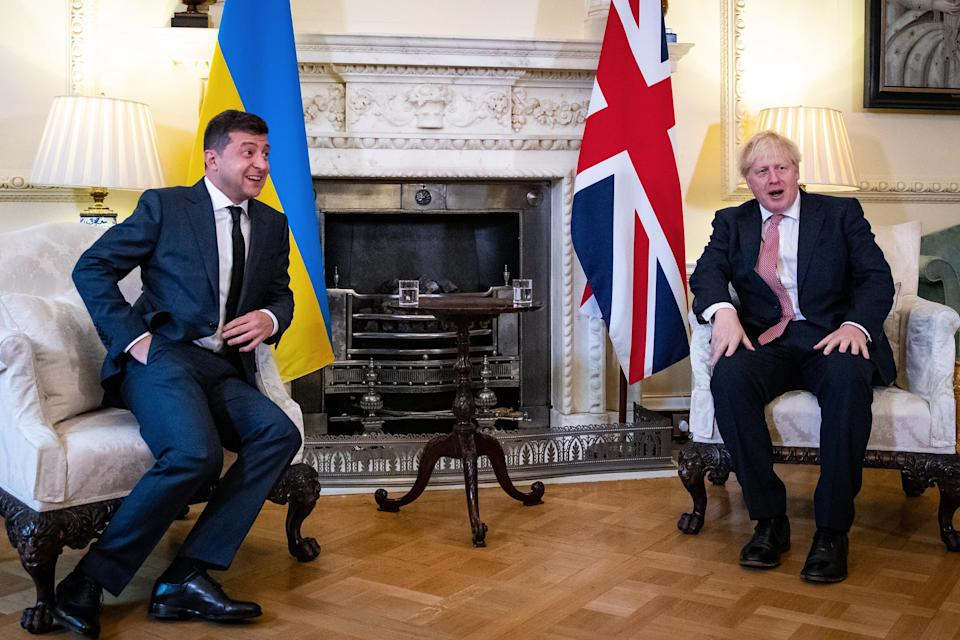 """Britain's Prime Minister Boris Johnson (R) and Ukraine's President Volodymyr Zelensky gesture during their meeting inside number 10 Downing Street, in central London on October 8, 2020. - Britain and Ukraine will on Thursday sign a """"strategic partnership agreement"""" to support Kiev's sovereignty """"in the face of Russia's destabilising behaviour"""", Prime Minister Boris Johnson's office said. (Photo by Aaron Chown / POOL / AFP) (Photo by AARON CHOWN/POOL/AFP via Getty Images)"""