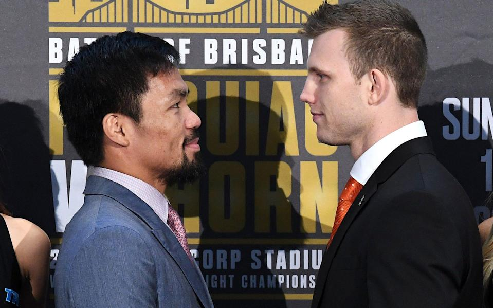 Boxers Manny Pacquiao of the Philippines and Australia's Jeff Horn stand together following their official news conference ahead of their WBO welterweight fight in Brisbane. (Reuters)
