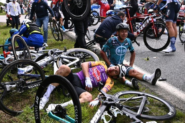 All fall down: Team B&B KTM's Bryan Coquard of France and a Team Alpecin Fenix' rider lie on the ground after crashing during the 1st stage of the Tour de France
