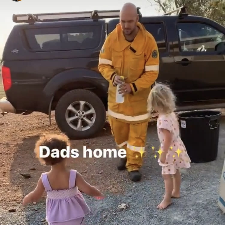 Temil Ludwig spent 27 hours fighting the fires near Yeppoon in Central Queensland. When he got home, his little girls gave him a hero's welcome. Source: Michelle Ludwig