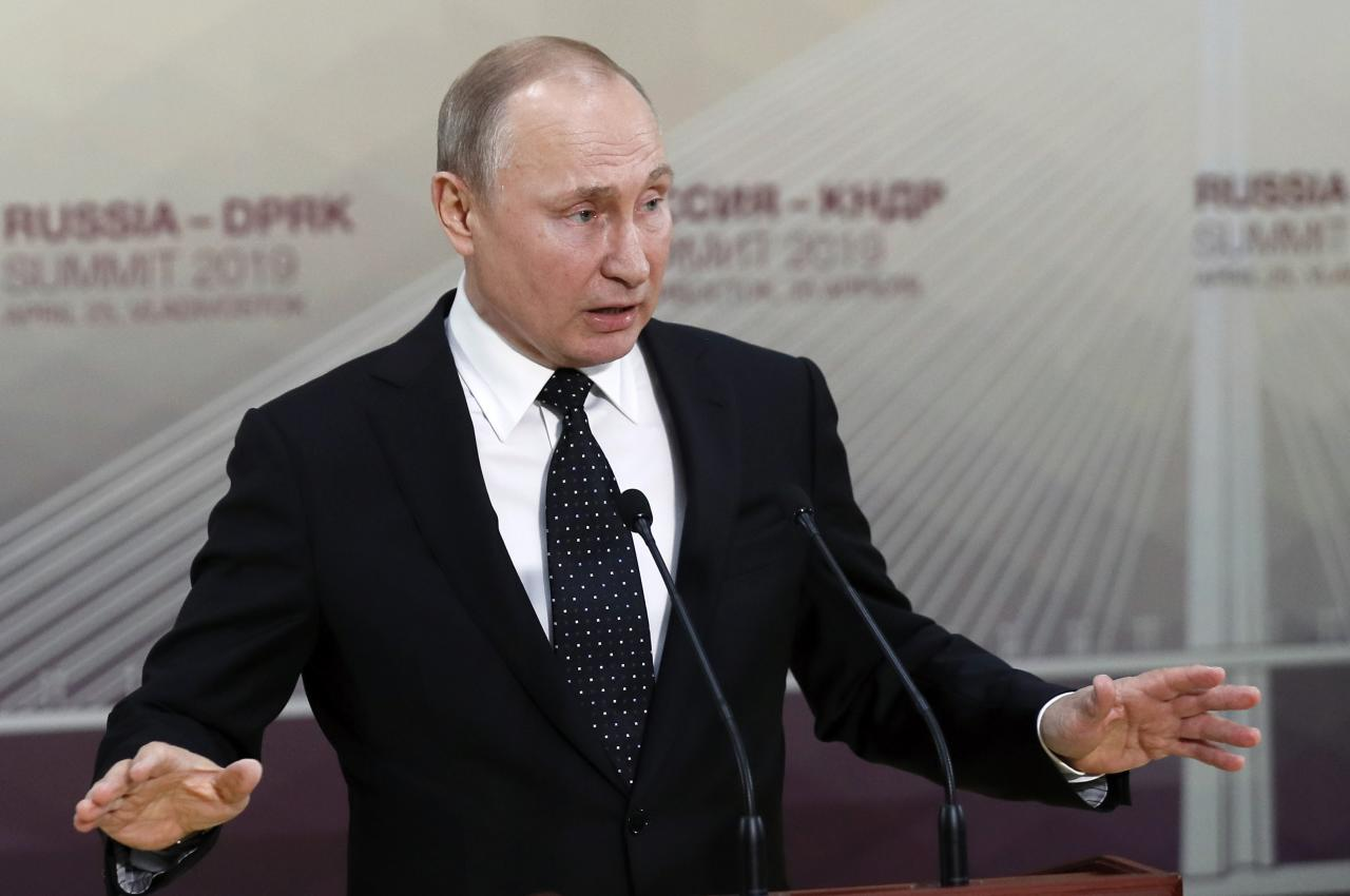 Russian President Vladimir Putin gestures while speaking to the media after his talks with North Korea's leader Kim Jong Un talk in Vladivostok, Russia, Thursday, April 25, 2019. President Vladimir Putin says after talks with North Korean leader Kim Jong Un that Pyongyang is ready to proceed toward denuclearization, but that it needs serious security guarantees to do so. (Sergei Ilnitsky/Pool Photo via AP)
