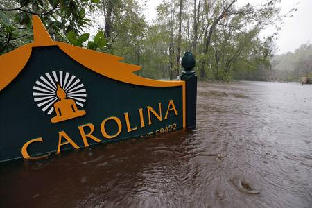 A sign for the Buddhist Association of North Carolina is partially submerged as waters rise after Hurricane Florence swept through, in Bolivia, North Carolina, U.S. September 15, 2018. REUTERS/Jonathan Drake