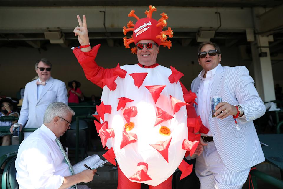 Mark Ferguson of Dallas, TX wears a Covid 19 costume prior to the 147th running of the Kentucky Derby at Churchill Downs on May 01, 2021 in Louisville, Kentucky. (Photo by Jamie Squire/Getty Images)