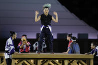 <p>Dancers perform during the opening ceremony in the Olympic Stadium at the 2020 Summer Olympics. (AP Photo/Natacha Pisarenko)</p>
