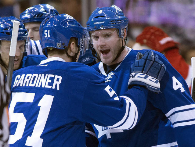 Toronto Maple Leafs defenseman Cody Franson (4) is congratulated by teammate Jake Gardiner after scoring against the Detroit Red Wings during first-period NHL hockey game action in Toronto, Saturday, March 29, 2014. (AP Photo/The Canadian Press, Frank Gunn)