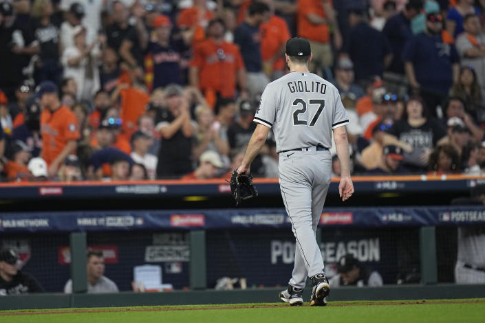 Chicago White Sox starting pitcher Lucas Giolito (27) is pulled from the game during the fifth inning in Game 2 of a baseball American League Division Series against the Houston Astros Friday, Oct. 8, 2021, in Houston. (AP Photo/David J. Phillip)