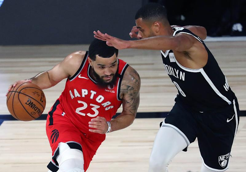 LAKE BUENA VISTA, FLORIDA - AUGUST 23: Fred VanVleet #23 of the Toronto Raptors moves the ball against Timothe Luwawu-Cabarrot #9 of the Brooklyn Nets during the first half in game four of the first round of the NBA playoffs at The Field House at ESPN Wide World Of Sports Complex on August 23, 2020 in Lake Buena Vista, Florida. NOTE TO USER: User expressly acknowledges and agrees that, by downloading and or using this photograph, User is consenting to the terms and conditions of the Getty Images License Agreement. (Photo by Kim Klement-Pool/Getty Images)