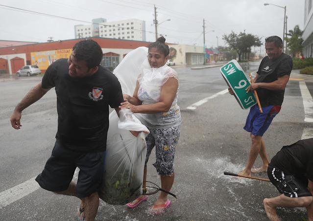 <p><strong>Miami</strong><br>People take time to clear debris out of a drainage ditch to keep the area from flooding as Hurricane Irma passes through on Sept. 10, 2017 in Miami, Fla. (Photo: Joe Raedle/Getty Images) </p>