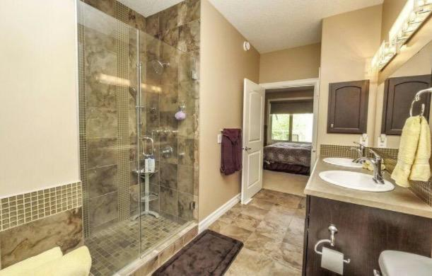 """<p><a href=""""https://www.zoocasa.com/search?listing-id=4564265"""" rel=""""nofollow noopener"""" target=""""_blank"""" data-ylk=""""slk:18343 Lessard Rd. Northwest"""" class=""""link rapid-noclick-resp"""">18343 Lessard Rd. Northwest</a><br>The master bathroom is large and well-equipped. </p>"""