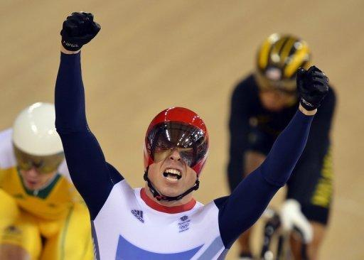 Britain's Chris Hoy celebrates after winning the gold medal in the men's keirin cycling final at the London Olympics on August 7. He won his sixth gold courtesy of victory in the keirin event which allowed him to overtake the five titles garnered by rower Steve Redgrave