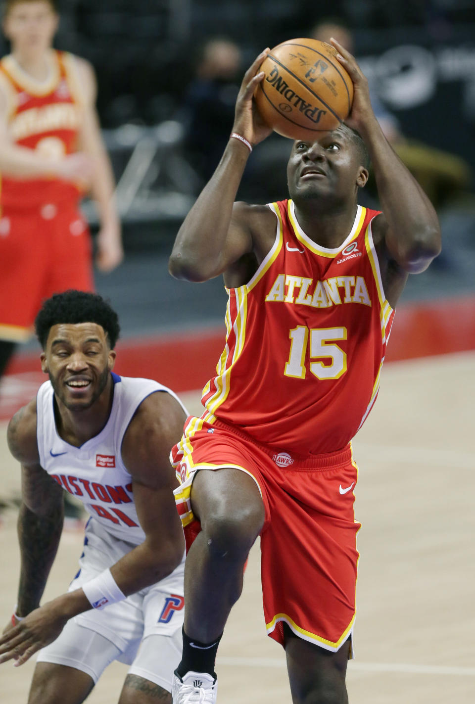 Atlanta Hawks center Clint Capela (15) goes to the basket past Detroit Pistons forward Saddiq Bey (41) during the first quarter of an NBA basketball game Monday, April 26, 2021, in Detroit. (AP Photo/Duane Burleson)
