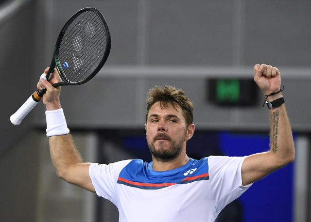 Switzerland's Stan Wawrinka celebrates after defeating Italy's Andreas Seppi in their second round singles match at the Australian Open tennis championship in Melbourne, Australia, Thursday, Jan. 23, 2020. (AP Photo/Andy Brownbill)