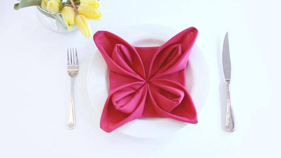 """<p>For a more formal affair, transform your cloth napkins into adorable blooms without paying for the real deal. Mix up the linens to create a colorful flower bed right on your table. </p><p><em><a href=""""https://www.goodhousekeeping.com/home/craft-ideas/videos/a37872/fold-napkins-into-flowers/"""" rel=""""nofollow noopener"""" target=""""_blank"""" data-ylk=""""slk:Get the tutorial »"""" class=""""link rapid-noclick-resp"""">Get the tutorial »</a></em> </p>"""