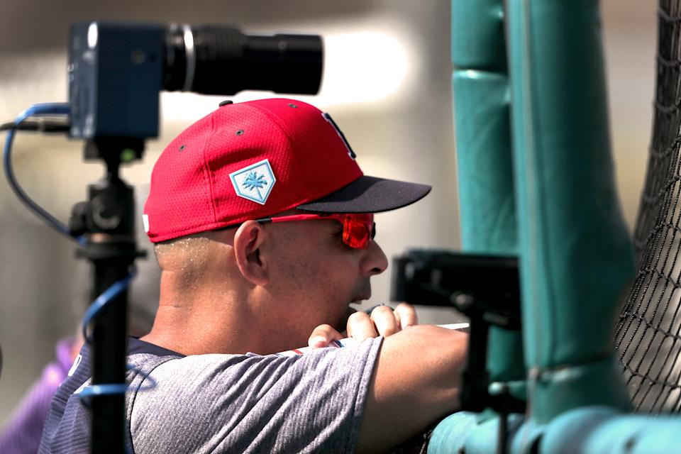 FORT MYERS, FL - FEBRUARY 17: Boston Red Sox manager Alex Cora is framed by a high speed camera as he watches a live batting practice session during a spring training workout at JetBlue Park in Fort Myers, FL on Feb. 17, 2019. (Photo by Barry Chin/The Boston Globe via Getty Images)