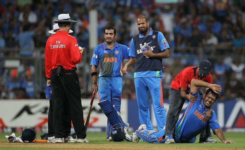 MS Dhoni getting treatment from the Indian physio