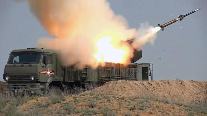 A Pantsir self-propelled surface-to-air and anti-aircraft missile system fires a missile
