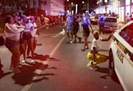 People leave the area as an 8 pm curfew goes into effect on March 21, 2021 in Miami Beach, Florida