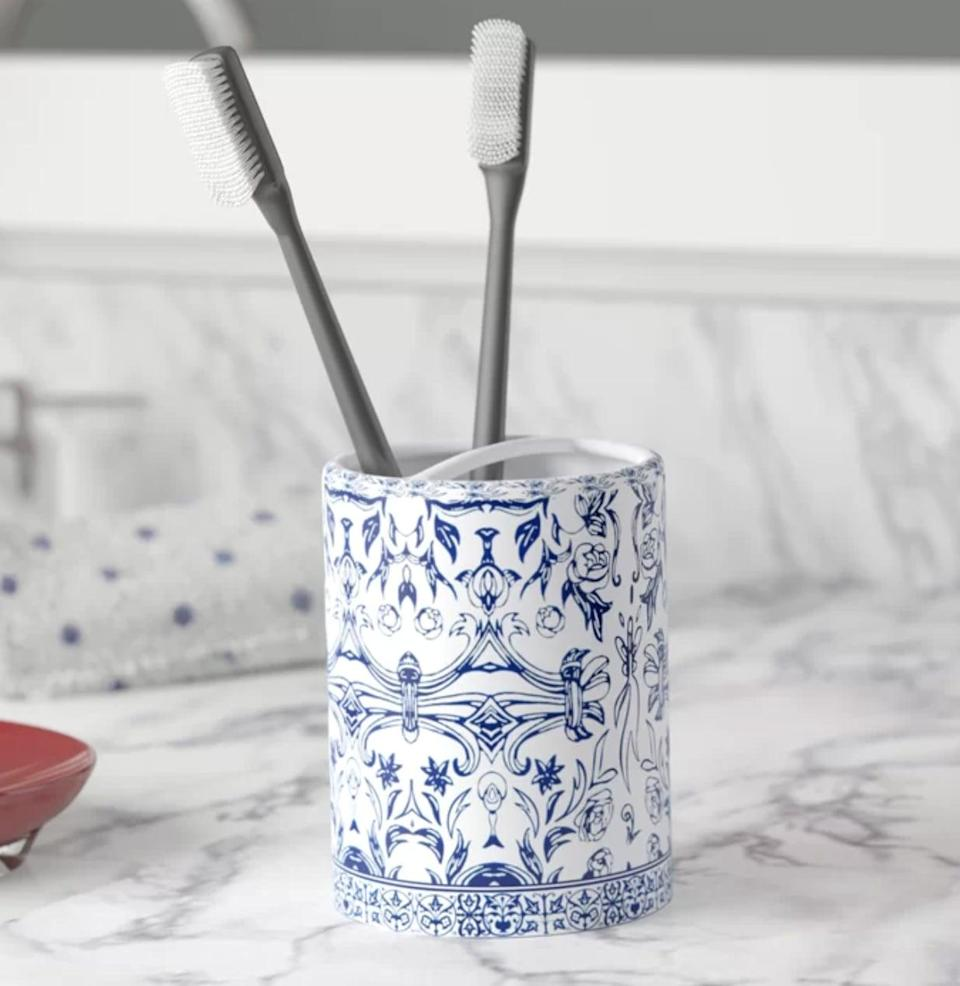 <p>If your style is more luxury than laidback, consider the <span>Mcglothlin Porcelain Toothbrush Holder</span> ($20). The cobalt blue floral design is inspired by Chinese ceramics. And, with two separate sections, you won't risk mixing up toothbrushes if you share a bathroom.</p>