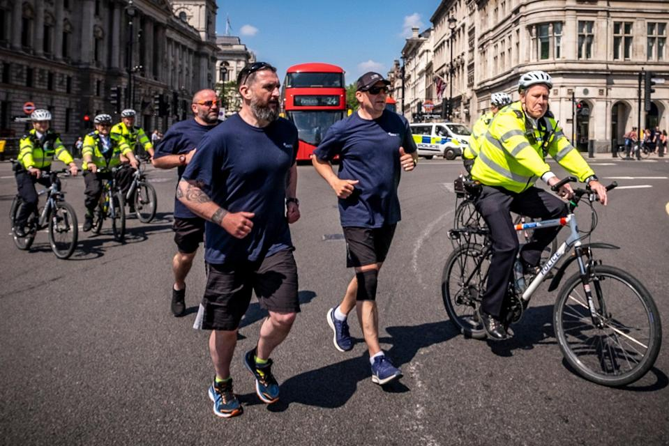 <p>PC Darren Sanders, PC Mick Gibson and Sgt Darren Laurie run to sites of recent terror attacks</p> (Jason Bye/MartisMedia)