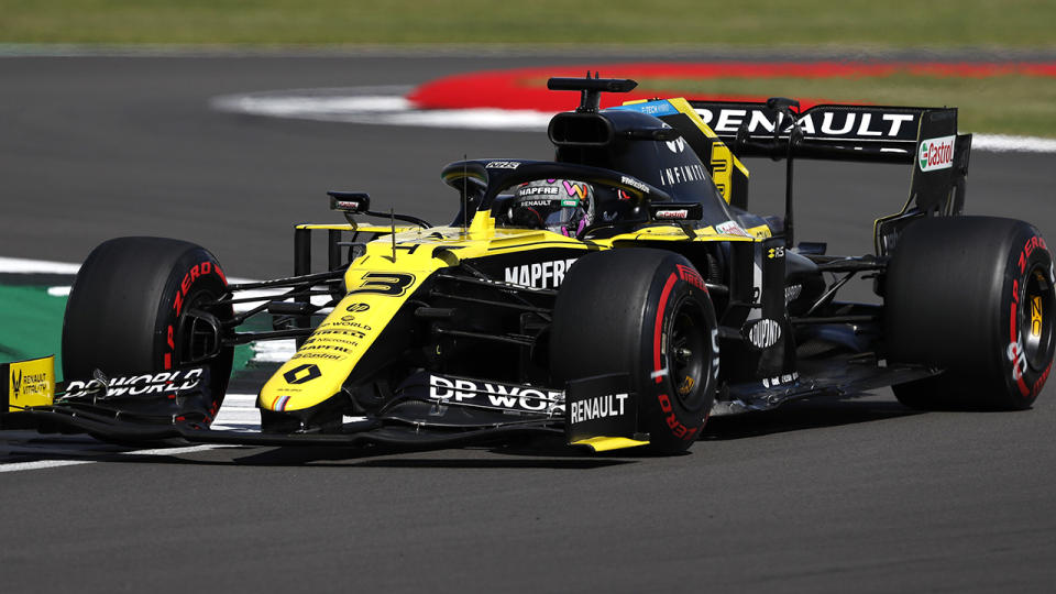 Daniel Ricciardo is pictured at the wheel of his Renault F1 car.