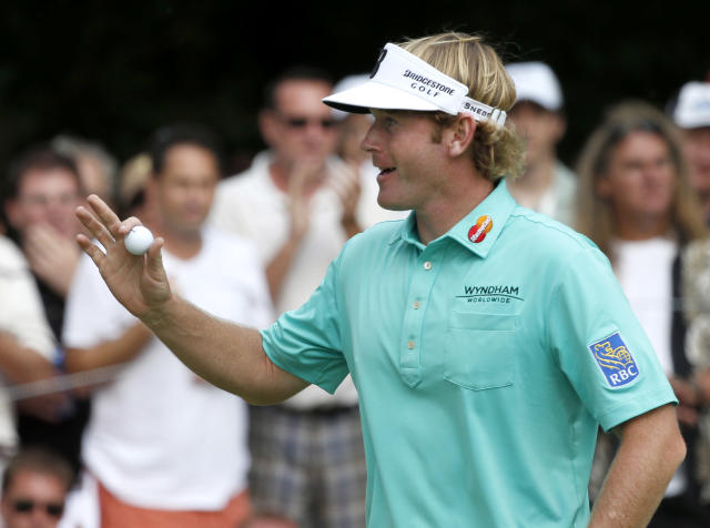 Brandt Snedeker acknowledges the crowd after finishing the first round of the BMW Championship golf tournament at Conway Farms Golf Club in Lake Forest, Ill., Thursday, Sept. 12, 2013. (AP Photo/Charles Rex Arbogast)