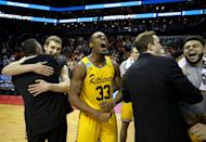 <p>Arkel Lamar #33 of the UMBC Retrievers reacts to their 74-54 victory over the Virginia Cavaliers during the first round of the 2018 NCAA Men's Basketball Tournament at Spectrum Center on March 16, 2018 in Charlotte, North Carolina. (Photo by Streeter Lecka/Getty Images) </p>
