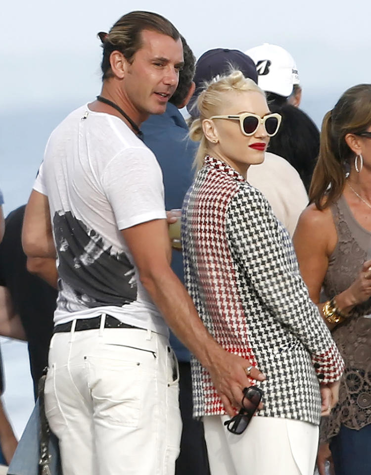 After 10 years of marriage and two kids together, Gwen Stefani and husband Gavin Rossdale still can't keep their hands off each other. Or rather, Gavin can't keep his hand off Gwen's rear end ... even at a fancy Memorial Day party in Malibu! (5/27/2013)