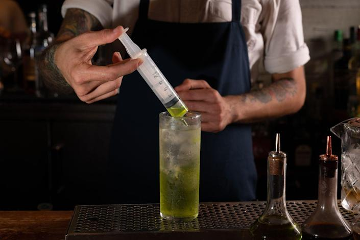 """<p><strong>Ingredients</strong></p><p>.75 oz Lemorton Calvados<br>.75 oz Fords Gin<br>.5 oz Re-Animator Transfusion*<br>2 oz Fever Tree Tonic<br>Soda<br>1 barspoon lime juice</p><p><strong>Instructions</strong></p><p>Build all ingredients (except Transfusion liqueurs) in Collins glass with ice, leaving one quarter of the glass unfilled. Fill plastic syringe half-way with """"Re-Animator Transfusion"""" and have drinker infuse drink upon serving.</p><p><em>*Re-Animator Transfusion: </em>.25 oz Midori, 1 barspoon of Strega Herbal Liqueur, 1 barspoon of Combier Abricot Liqueur</p><p><em>Recipe Courtesy of Brian Evans, Bar Director of Sunday Hospitality (<a href=""""http://www.sundayinbrooklyn.com/"""" rel=""""nofollow noopener"""" target=""""_blank"""" data-ylk=""""slk:Sunday In Brooklyn"""" class=""""link rapid-noclick-resp"""">Sunday In Brooklyn</a>, <a href=""""http://www.thirdsbk.com/"""" rel=""""nofollow noopener"""" target=""""_blank"""" data-ylk=""""slk:Rule Of Thirds"""" class=""""link rapid-noclick-resp"""">Rule Of Thirds</a>)</em></p>"""