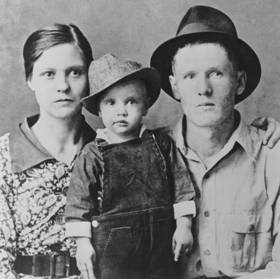 Two-year-old Elvis with his parents Vernon Presley and Gladys Presley