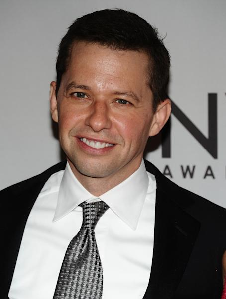 FILE - This June 12, 2011 file photo shows actor Jon Cryer arriving at the 65th annual Tony Awards in New York. On Sunday, Sept. 16, 2012, Cryer injured himself during the cycling part of a triathlon after losing control of his bicycle. He suffered scrapes and bruises but no broken bones. (AP Photo/Charles Sykes, file)