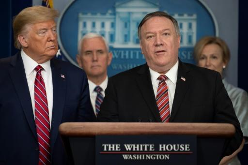 US President Donald Trump listens as Secretary of State Mike Pompeo speaks during the daily briefing on the novel coronavirus at the White House